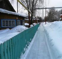 14.02.2017. Чистят снег по Урдоме, ул. Центральная, на пересечении с Ленина.